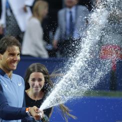 Spain's Rafael Nadal sprays sparkling wine as he celebrates after winning the Barcelona Open tennis tournament in Barcelona, Spain, Sunday, April 24, 2016. Spain's Rafael Nadal defeated Japans Kei Nishikori 6-4 and 7-5, in the final. (AP Photo/Manu Fernan