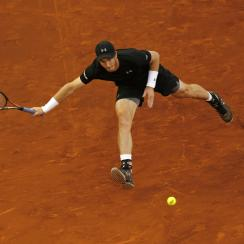 Andy Murray, from Britain, runs to return a ball against Radek Stepanek, from Czech Republic, during a Madrid Open tennis tournament match in Madrid, Spain, Tuesday, May 3, 2016. Murray won 7-6, 3-6 and 6-1. (AP Photo/Francisco Seco)