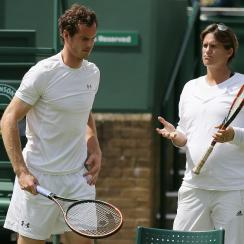 FILE - A Saturday, June 27, 2015 photo from files showing Britains Andy Murray, left, speaking with his coach Amelie Mauresmo during practice ahead of the the All England Lawn Tennis Championships in Wimbledon, London. Andy Murray split with coach Amelie