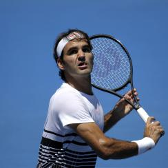 Switzerland's Roger Federer looks to play a backhand return during a practice session ahead of the Australian Open tennis championships in Melbourne, Australia, Thursday, Jan. 12, 2017. (AP Photo/Mark Baker)