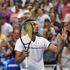 Australia's Nick Kyrgios waves to the crowd after defeating Portugal's Gasto Elias in their first round match at the Australian Open tennis championships in Melbourne, Australia, Monday, Jan. 16, 2017. (AP Photo/Andy Brownbill)