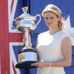 FILE - In this Jan. 30, 2011, file photo, Belgium's Kim Clijsters poses for photographers with her Australian Open trophy at Melbourne's Brighton Beach, Australia. Clijsters and Andy Roddick have been elected to the International Tennis Hall of Fame. (AP