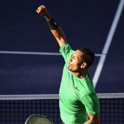 Nick Kyrgios, of Australia, celebrates after beating Novak Djokovic, of Serbia, at the BNP Paribas Open tennis tournament, Wednesday, March 15, 2017, in Indian Wells, Calif. (AP Photo/Mark J. Terrill)