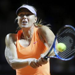 FILE - A Wednesday, April 26, 2017 file photo showing Russia's Maria Sharapova hitting a backhand against Italy's Roberta Vinci at the Porsche Tennis Grand Prix in Stuttgart, Germany.  Maria Sharapova recovered from a shaky opening to defeat Mirjana Lucic