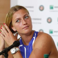 FILE - In this May 26, 2017, file photo, Petra Kvitova of the Czech Republic adjusts her hair during a press conference at Roland Garros stadium in Paris. Kvitova will continue her comeback from a knife attack by playing at the Connecticut Open in August,