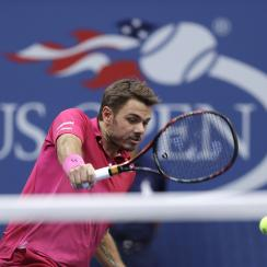 FILE - In this Sept. 11, 2016, file photo, Stan Wawrinka, of Switzerland, returns a shot to Novak Djokovic, of Serbia, during the men's singles final at the U.S. Open tennis tournament, in New York. Defending champion Stan Wawrinka has pulled out of the U
