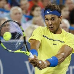 File-This Aug. 18, 2017, file photo shows Rafael Nadal, of Spain, returning to Nick Kyrgios, of Australia, at the Western & Southern Open tennis tournament in Mason, Ohio. (AP Photo/John Minchillo, File)