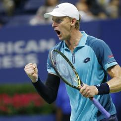 Kevin Anderson, of South Africa, reacts winning the third set in a quarterfinal against Sam Querrey, of the United States, at the U.S. Open tennis tournament in New York, early Wednesday, Sept. 6, 2017. (AP Photo/Kathy Willens)