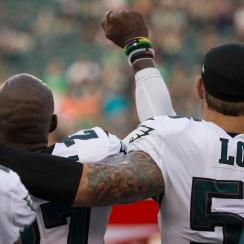 Chris Long Puts Arm Around Teammate Malcolm Jenkins in Support During Anthem Protest