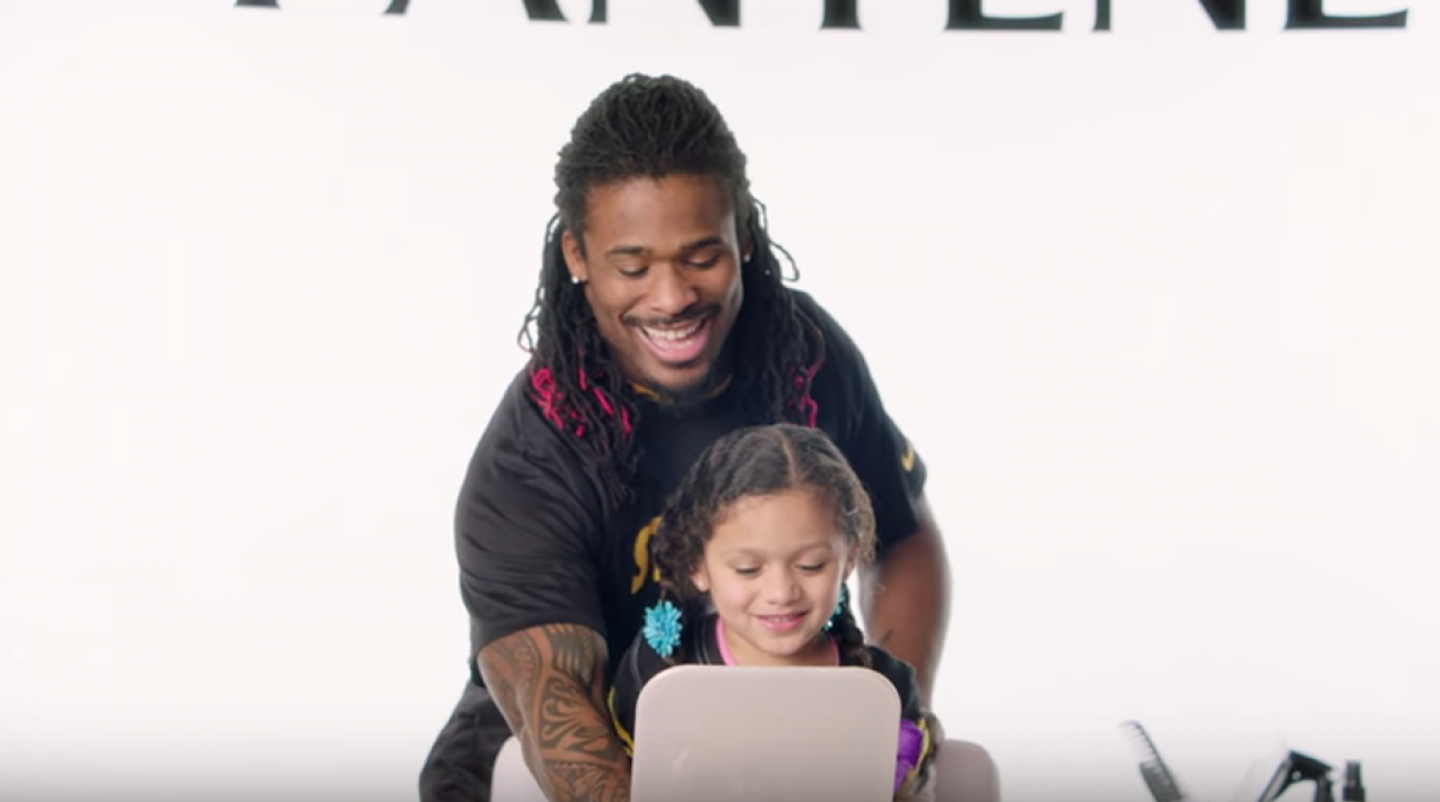 DeAngelo Williams does daughter's hair in Pantene commerical