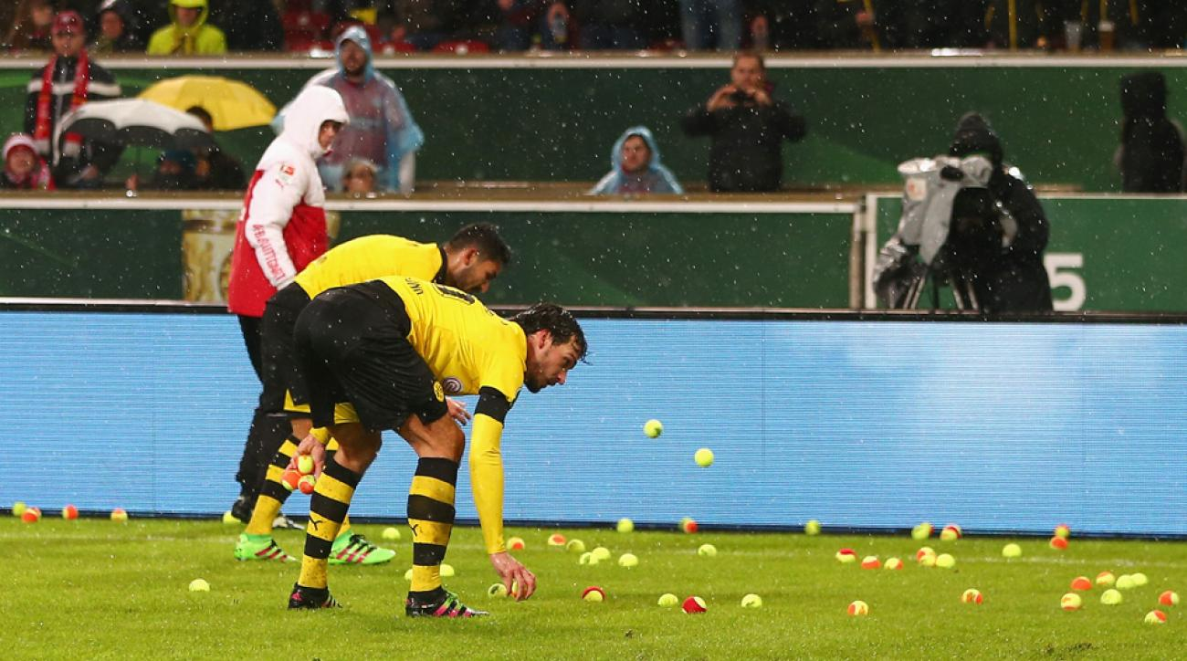 Dortmund fans threw tennis balls onto the field in protest of ticket prices