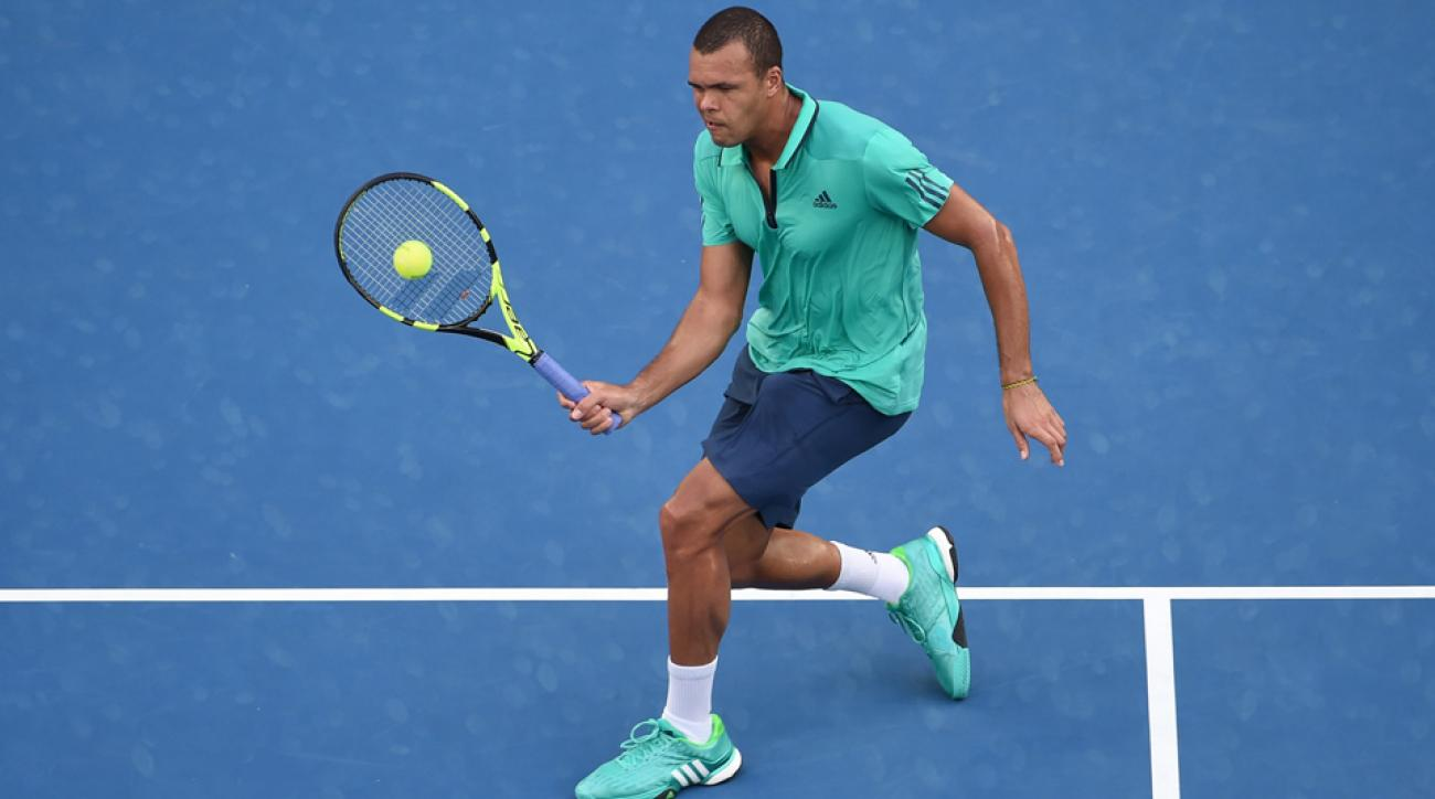 jo wilfried tsonga australian open helps ball girl