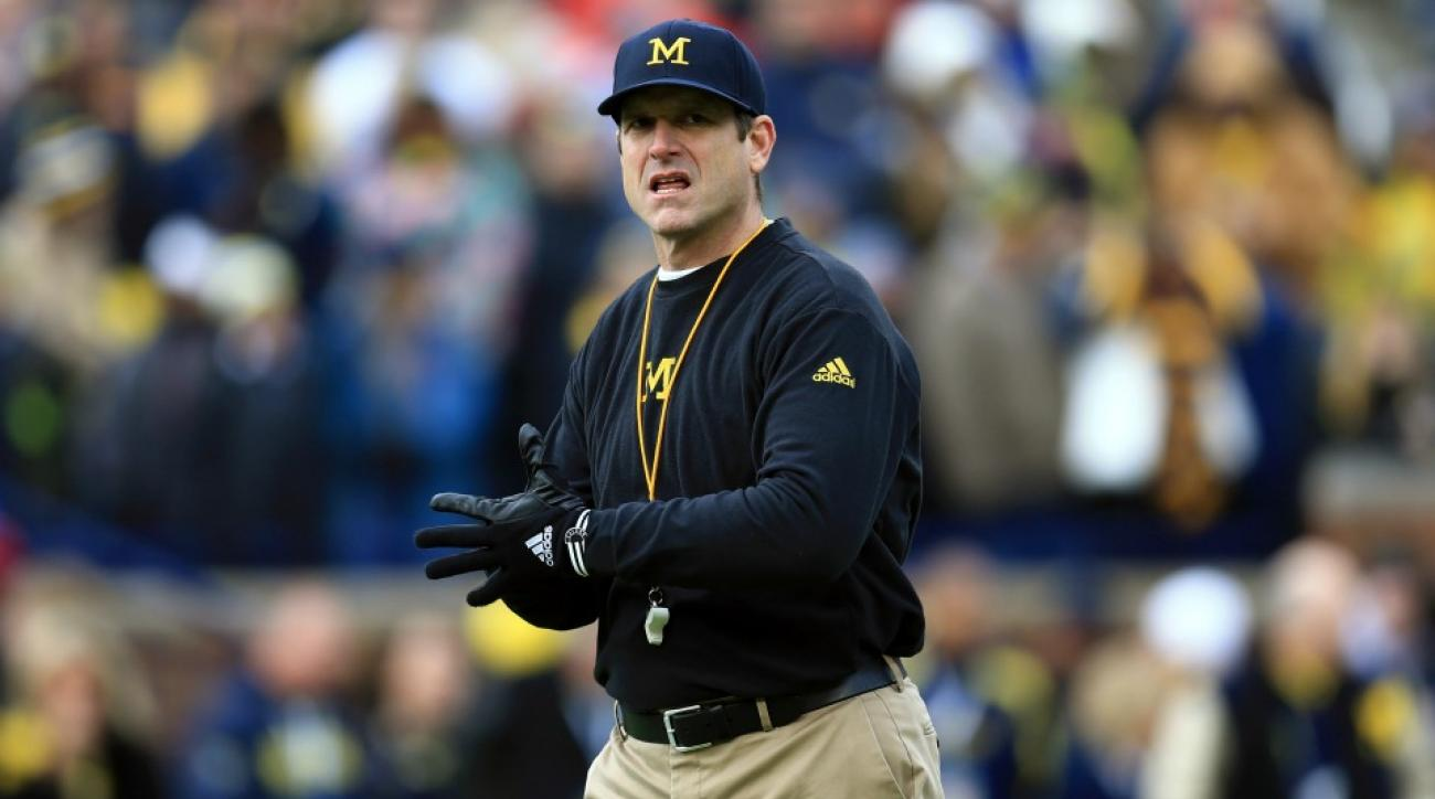 Michigan's Jim Harbaugh sits in on class with recruit