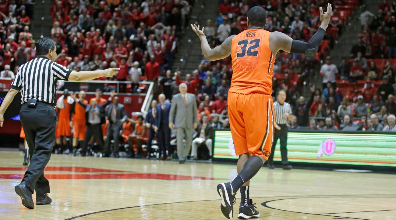 oregon state suspends jarmal reid tripping referee