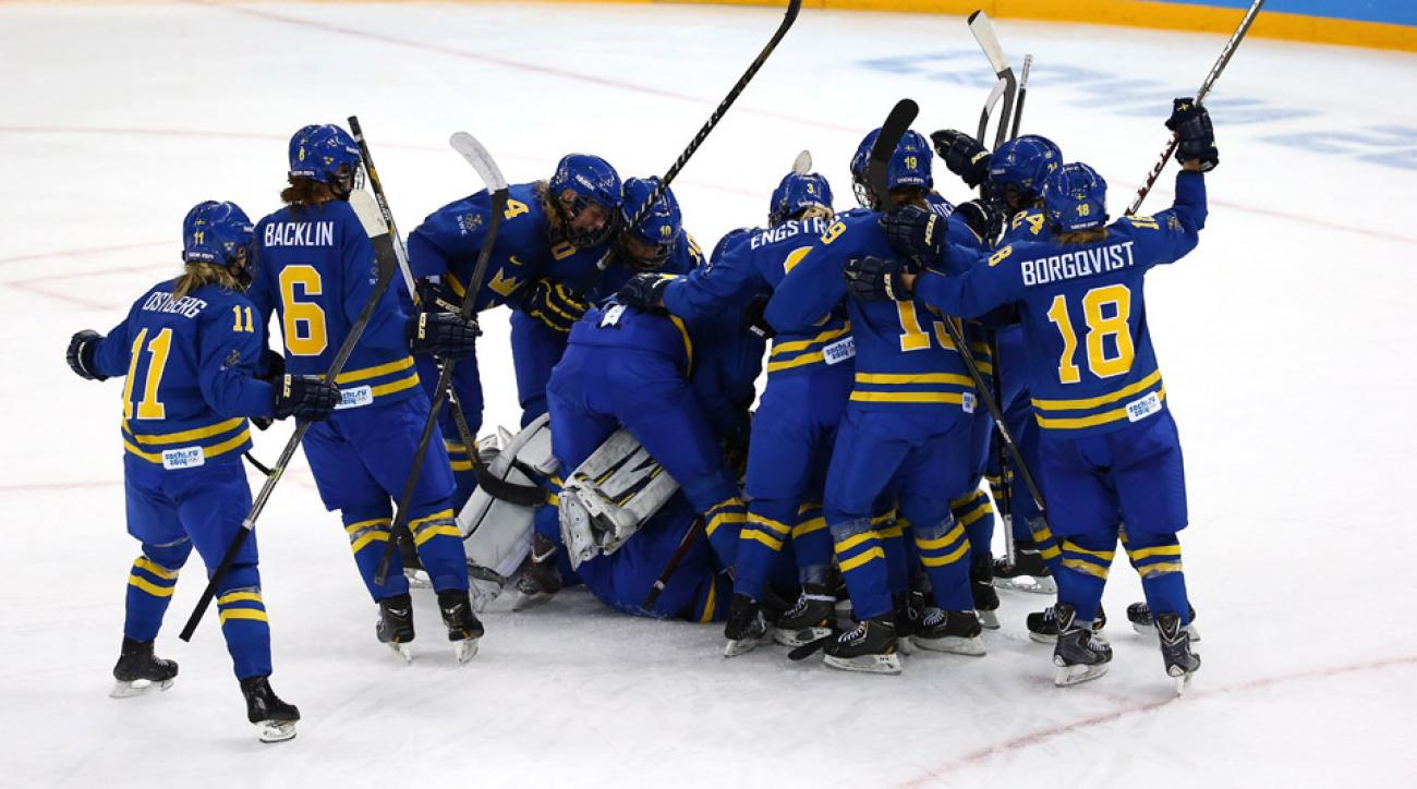Team Sweden celebrates after defeating Finland 4 to 2 in the Women's Ice Hockey Playoffs Quarterfinal game on day eight of the Sochi 2014 Winter Olympics