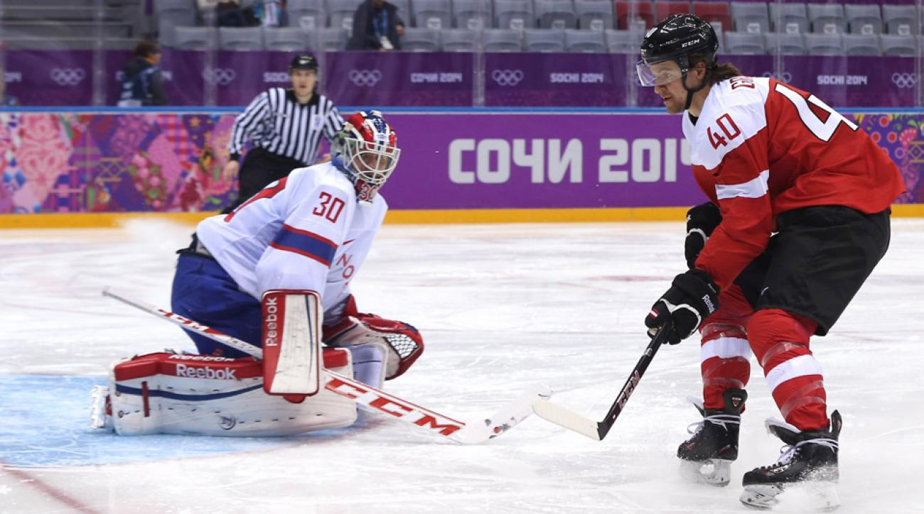 Michael Rene Grabner #40 of Austria takes a shot on Lars Haugen #30 of Norway during the Men's Ice Hockey Preliminary Round Group B game on day nine of the Sochi 2014 Winter Olympics at Bolshoy Ice Dome on February 16, 2014 in Sochi, Russia.
