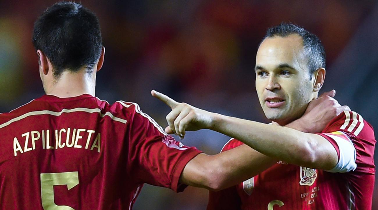 Spain's Andres Iniesta, right, celebrates his goal vs. Bolivia with Cesar Azpilicueta.