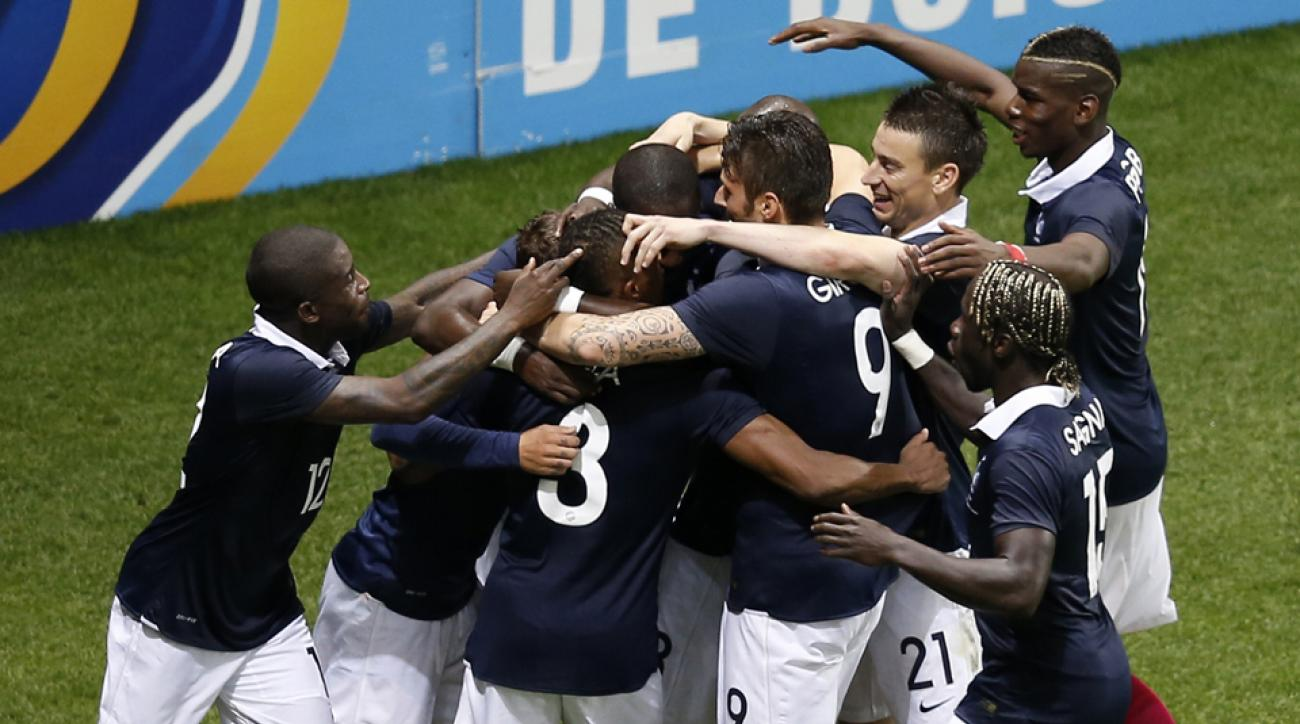 France players celebrate Antoine Griezmann's goal during Sunday's 1-1 draw with Paraguay