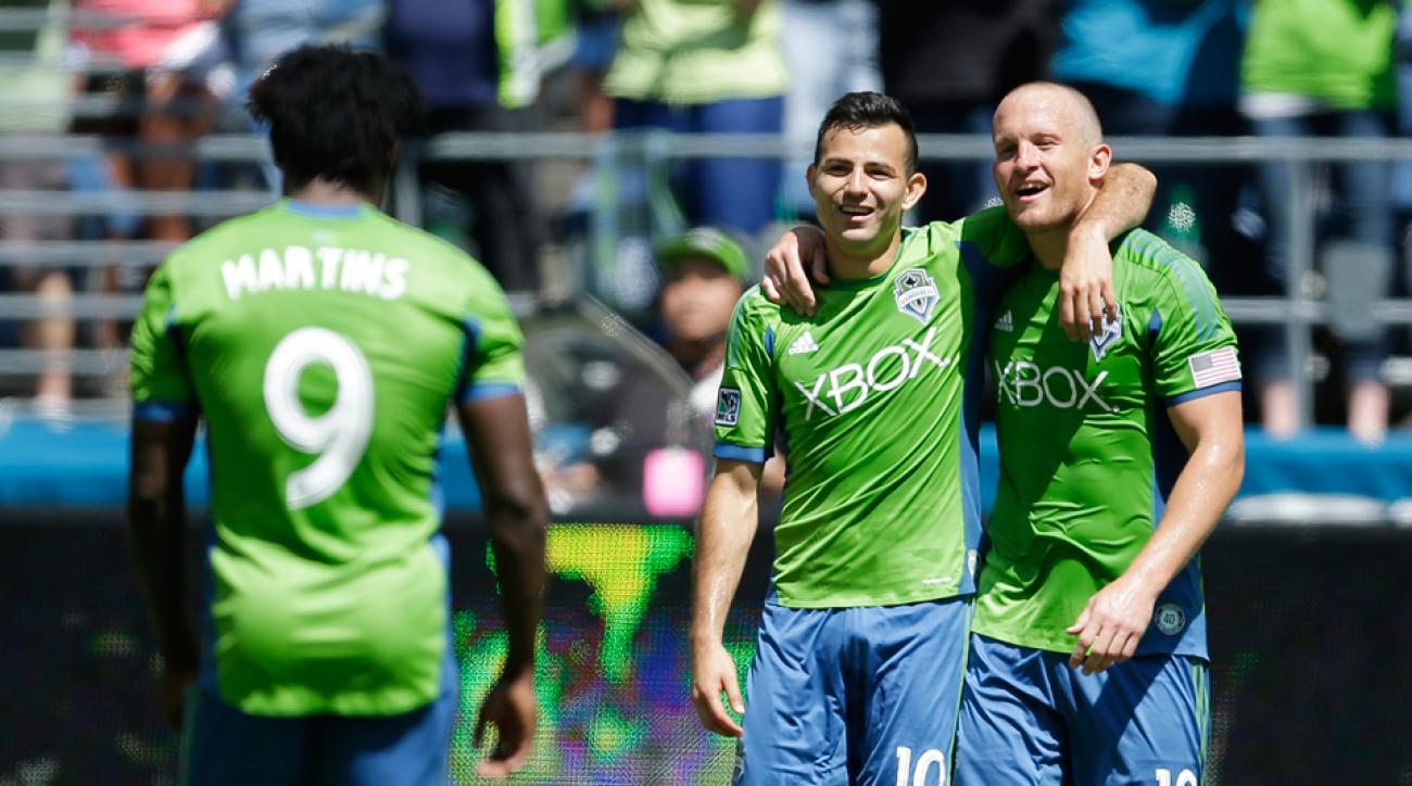 Seattle Sounders goal scorers (from left) Obafemi Martins, Marco Pappa and Chad Barrett lifted the club to a comfortable win over previously unbeaten Real Salt Lake.