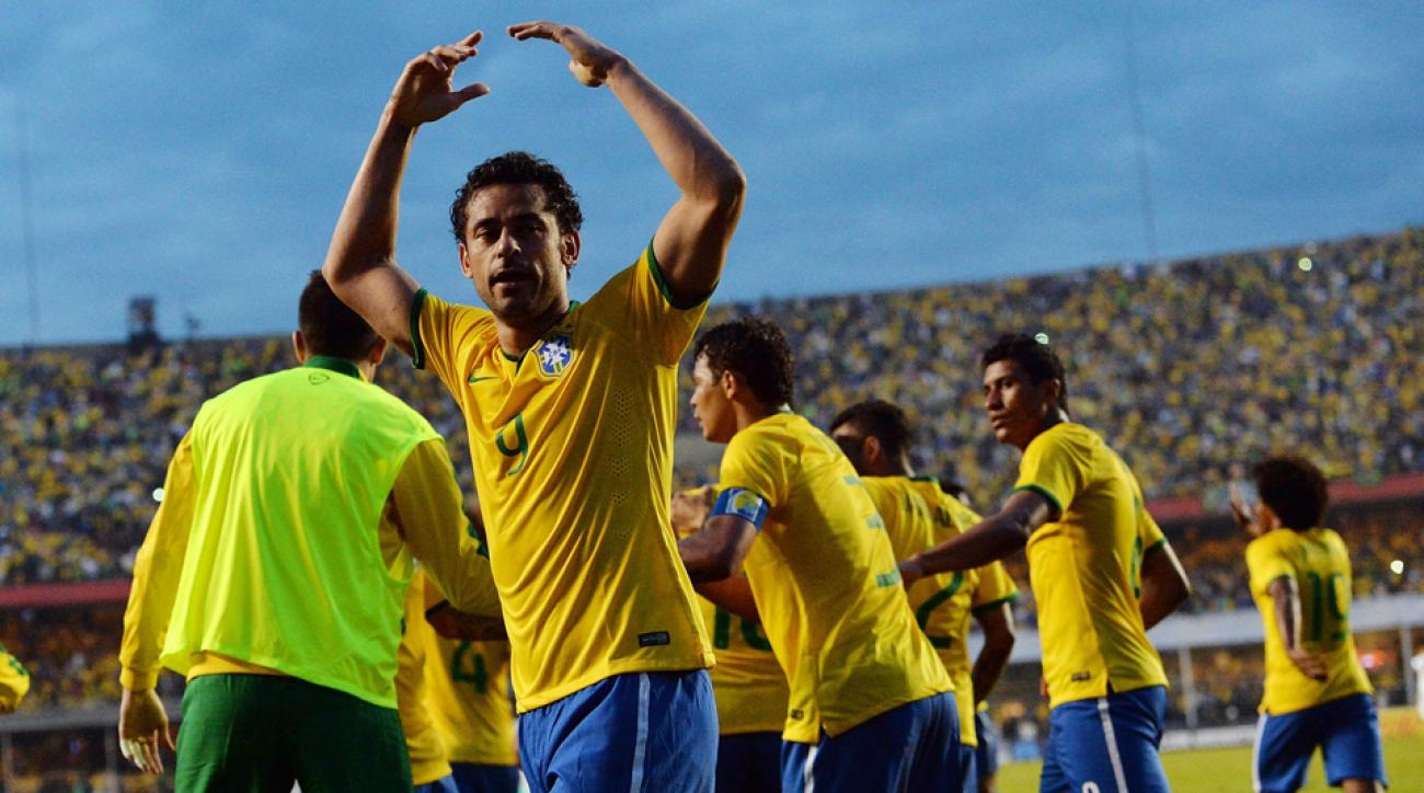 Brazil forward Fred (9) celebrates his goal that led the Selecao to a 1-0 victory over Serbia in the World Cup host nation's final tune-up match.