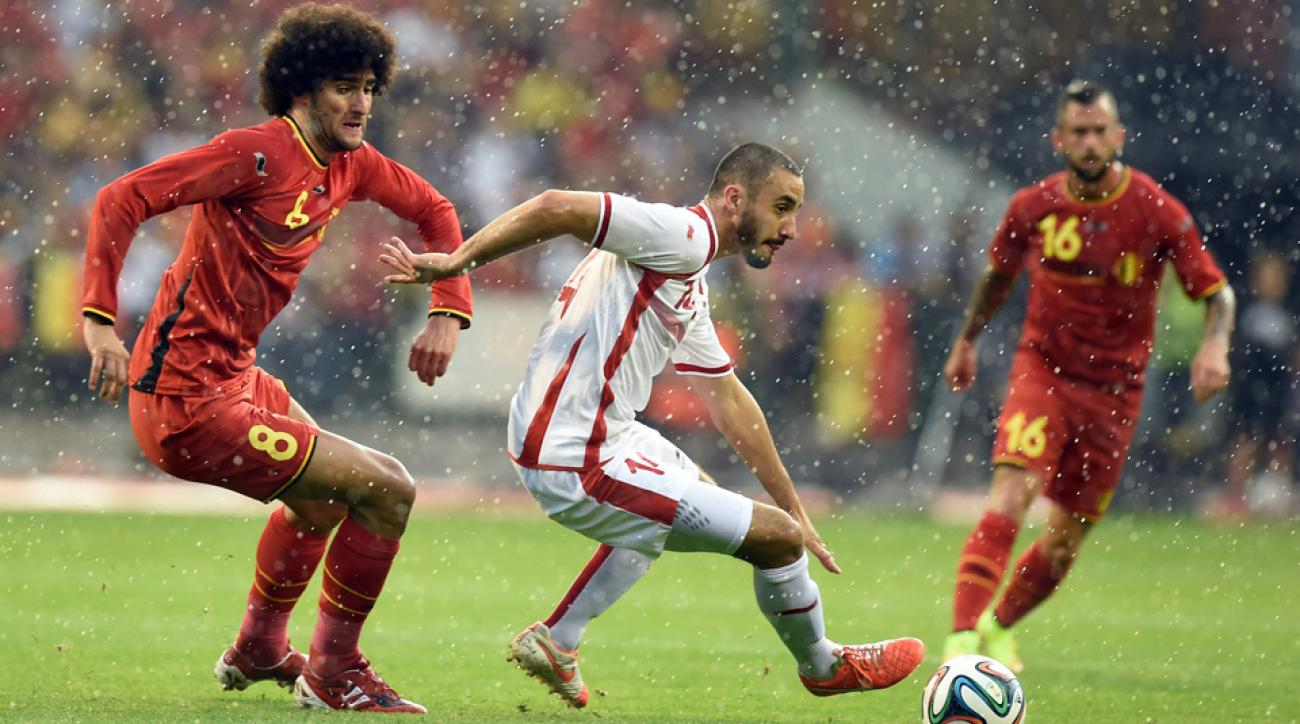 Belgium's Marouane Fellaini tracks Tunisia's Houcine Nater during the Red Devils' 1-0 win in their final World Cup tune-up.