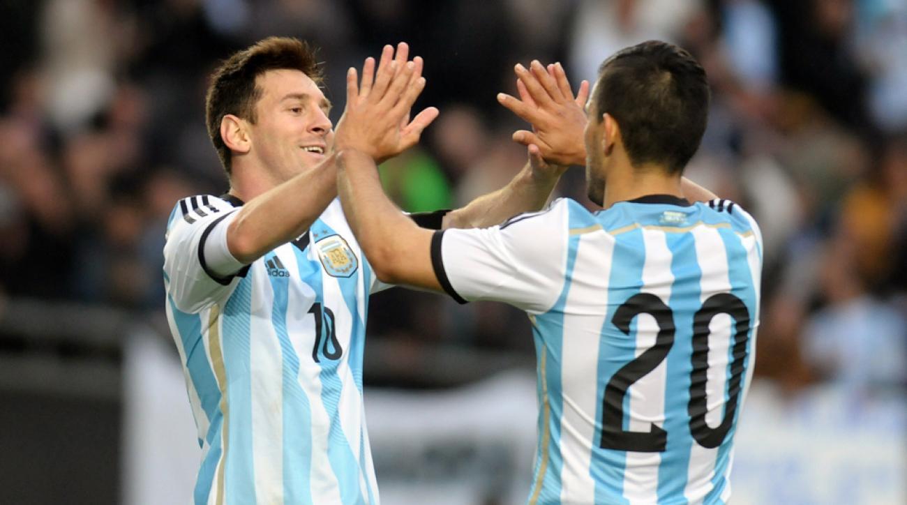 Lionel Messi, left, celebrates his goal against Slovenia with Sergio Aguero.