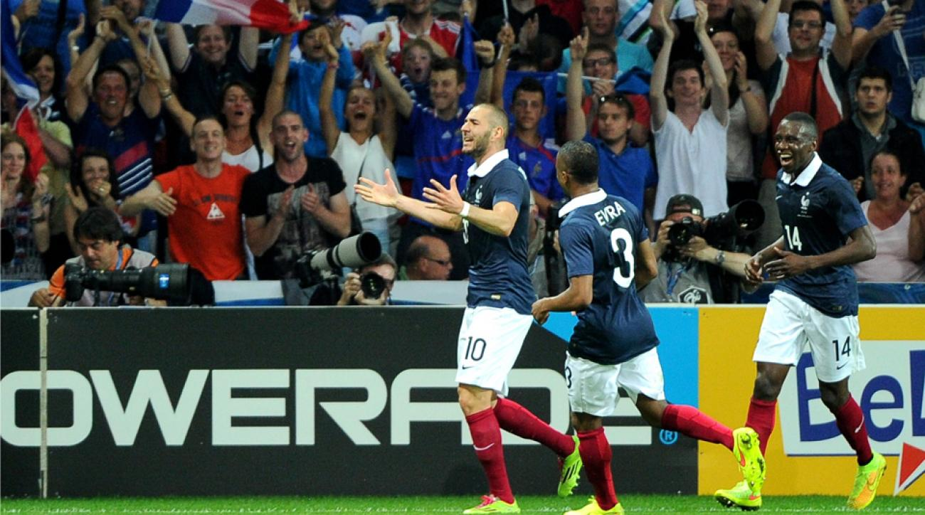 It was all fun and games for Karim Benzema (10) and his France teammates, who celebrate above after a goal during an 8-0 rout of Jamaica on Sunday.