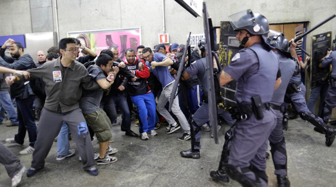 Sao Paulo police clash with subway operators on Monday as a strike continues to intensify with in the city slated to host the World Cup's opening game.