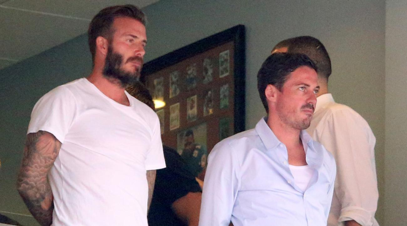 David Beckham, left, and business partner Marcelo Claure, pictured above at England's friendly vs. Honduras in Miami, will have to look for a third potential stadium site for a proposed MLS expansion franchise in South Florida.