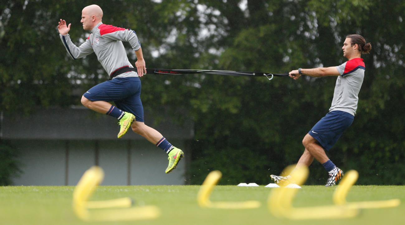 Michael Bradley, left, and Graham Zusi team on resistance exercises during training at Sao Paulo FC on Tuesday.