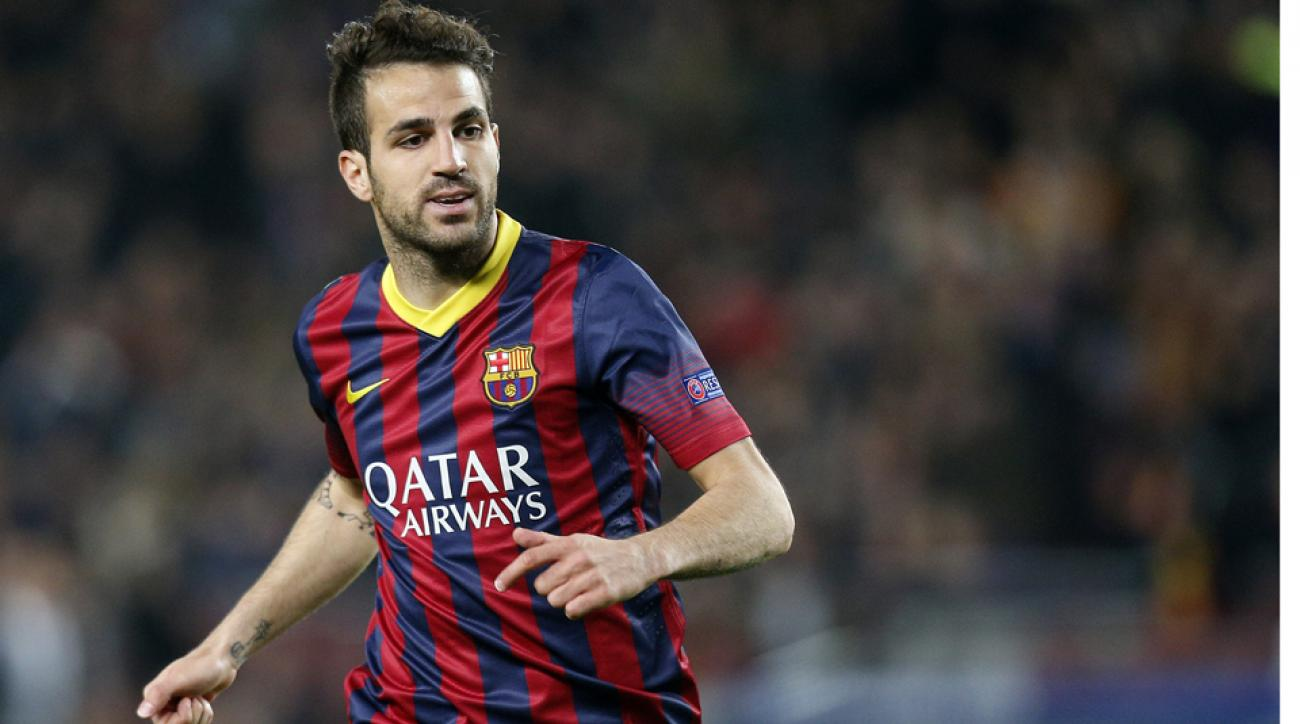 On the day of the World Cup opener, Cesc Fabregas completed his move from Barcelona to Chelsea on a five-year deal.