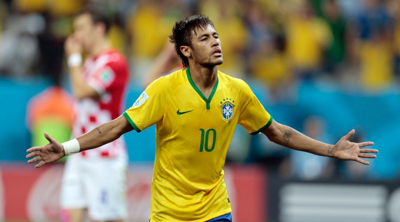 Neymar scored the first two World Cup goals of his career to help Brazil to a 3-1 win over Croatia.