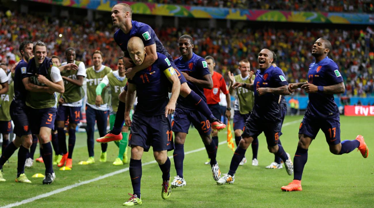 Netherlands players swarm Arjen Robben after one of his two goals in the nation's shock 5-1 rout of Spain in a rematch of the 2010 World Cup final.