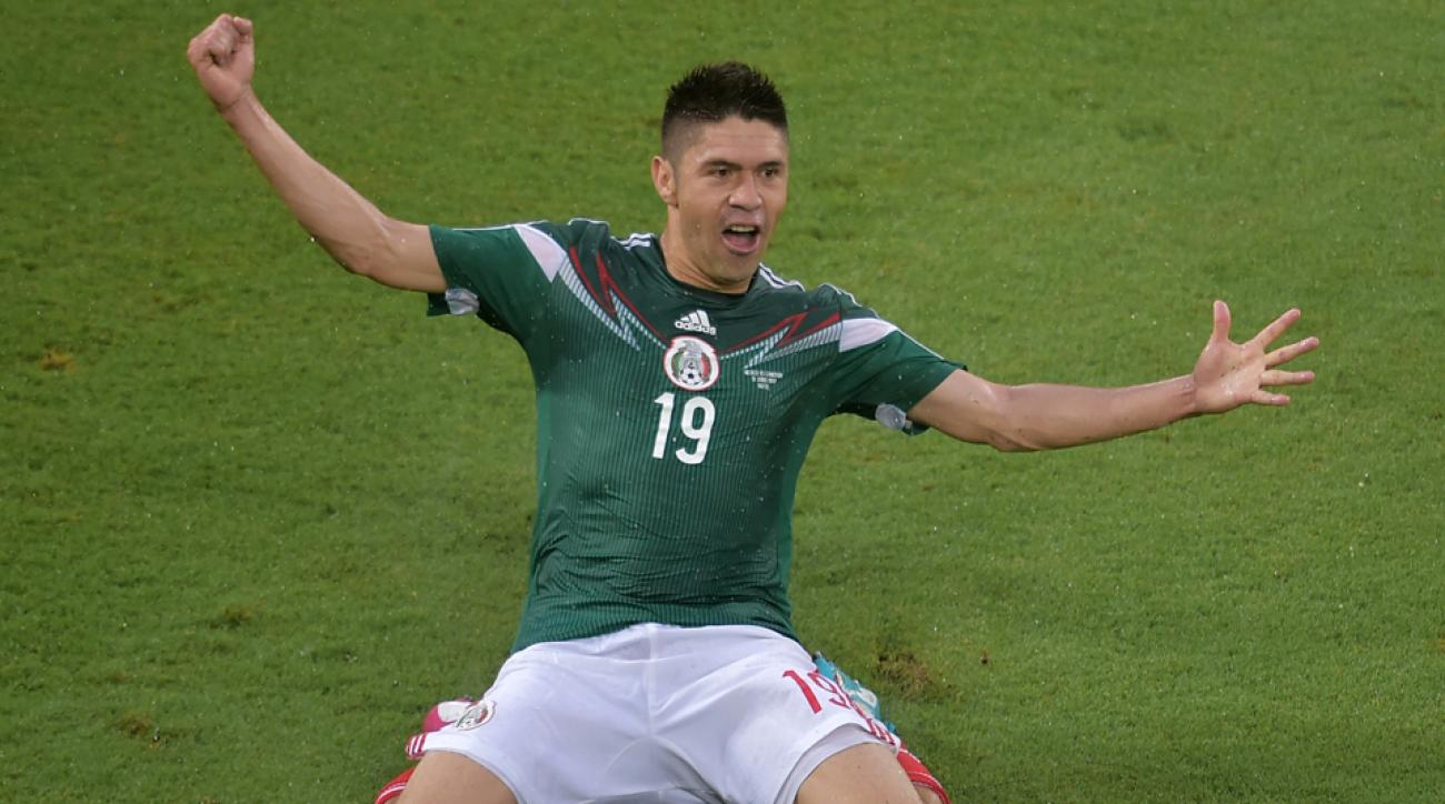 Mexico forward Oribe Peralta celebrates his goal that gives El Tri a 1-0 lead over Cameroon in the teams' World Cup opener.