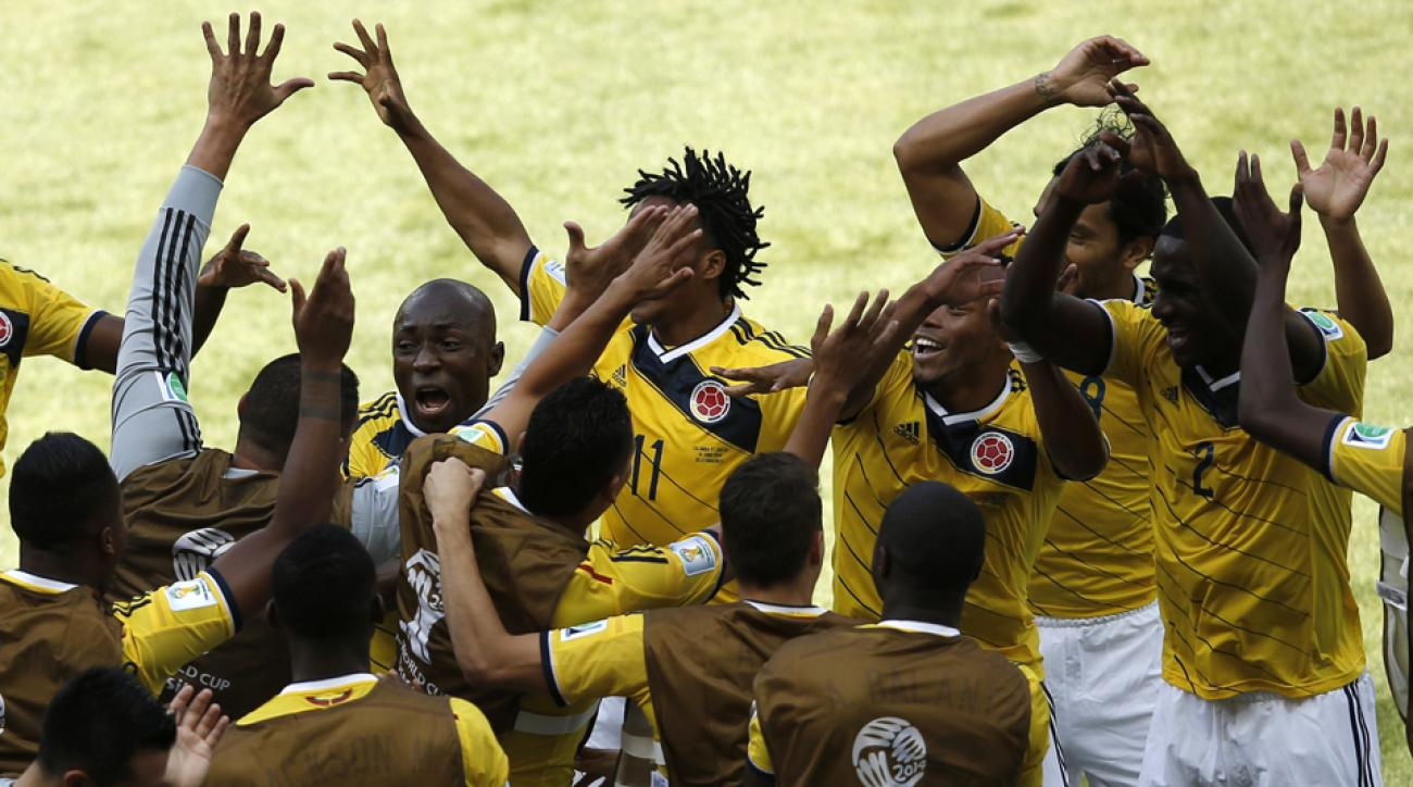 Pablo Armero leads Colombia's raucous celebration on the sideline after his opening goal against Greece on Saturday.