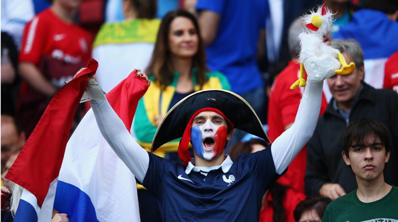 French fans, such as this one, in Porto Alegre were robbed of the chance to sing ''La Marseillaise'' as FIFA failed to play the French and Honduran national anthems prior to their Group E contest.