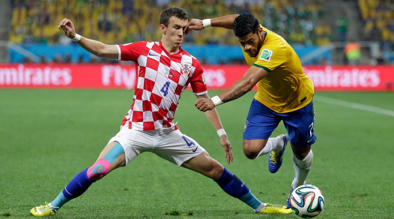 Brazil forward Hulk, right, left Sunday's training session with an apparent left leg injury.