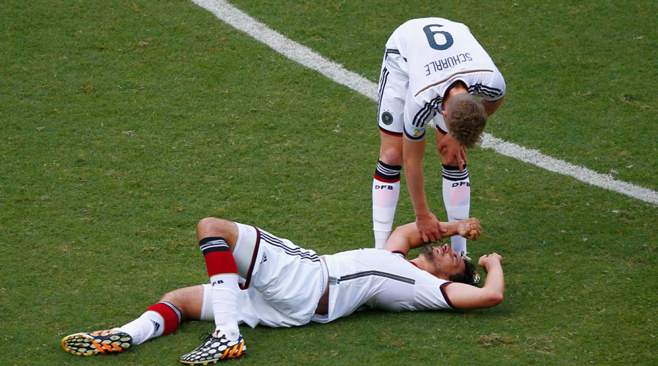 Germany's Andre Schurrle checks on teammate Mats Hummels, who suffered a thigh injury in the team's 4-0 win over Portugal on Monday.