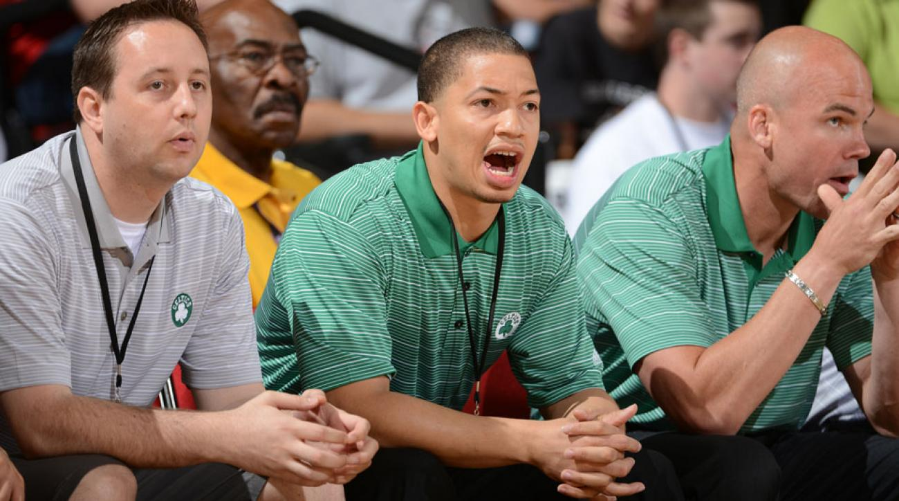 Tyronn Lue (center) is reportedly one of two finalist for Cleveland's head coaching job.