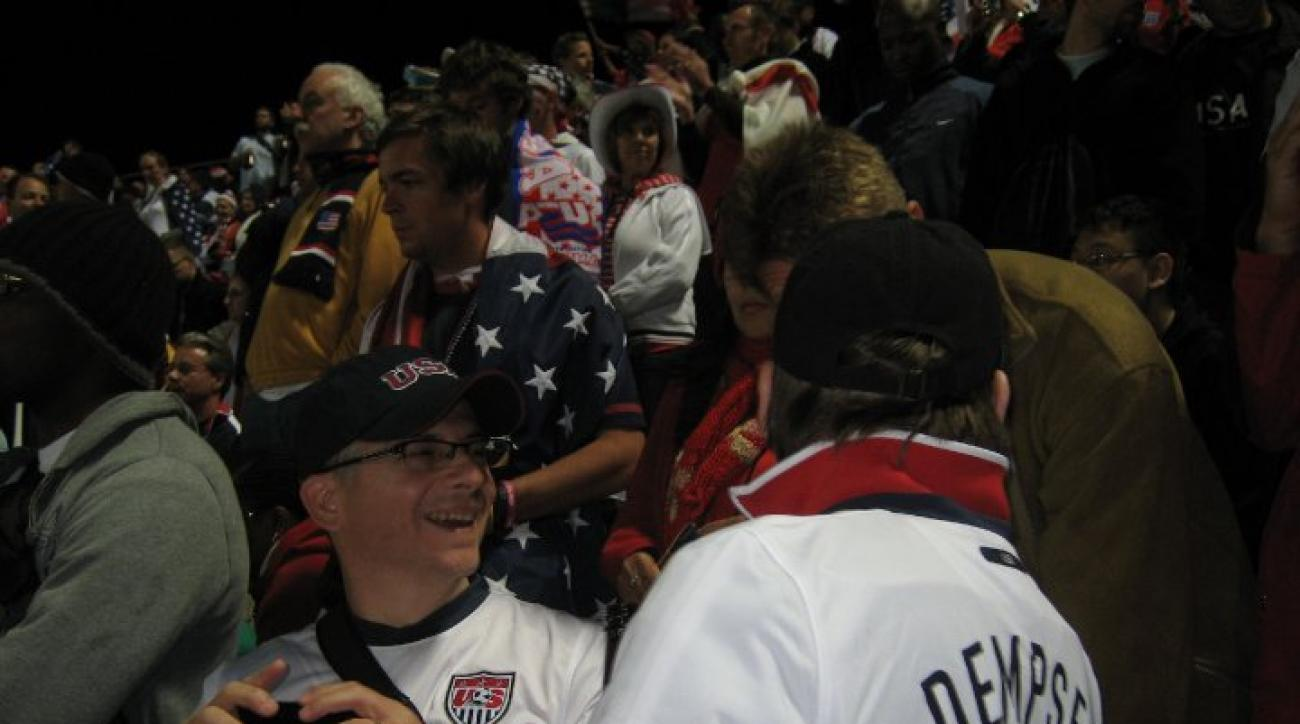 Josh Davis and his father having some fun with opposing fans at the 2010 USA-England match. Davis flew to South Africa for one night for the game.
