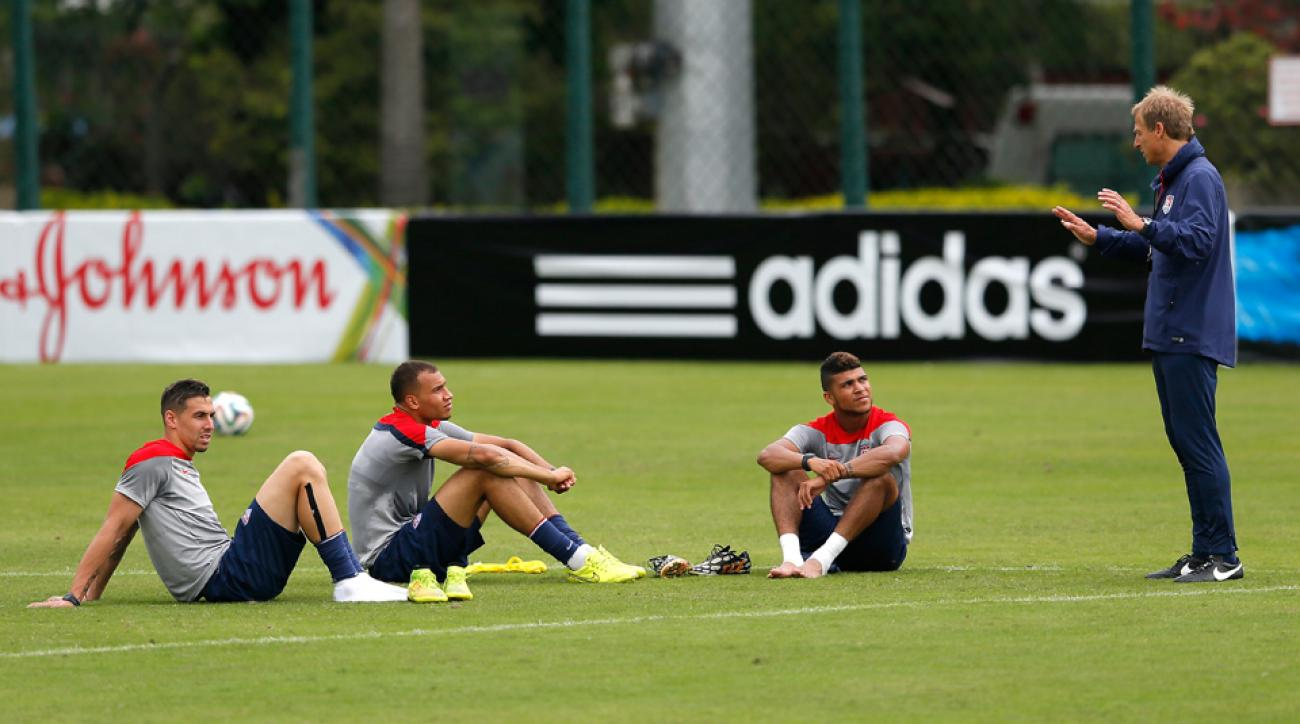 Jurgen Klinsmann provides instruction for (from left) Geoff Cameron, John Brooks and DeAndre Yedlin during U.S. training in Brazil.