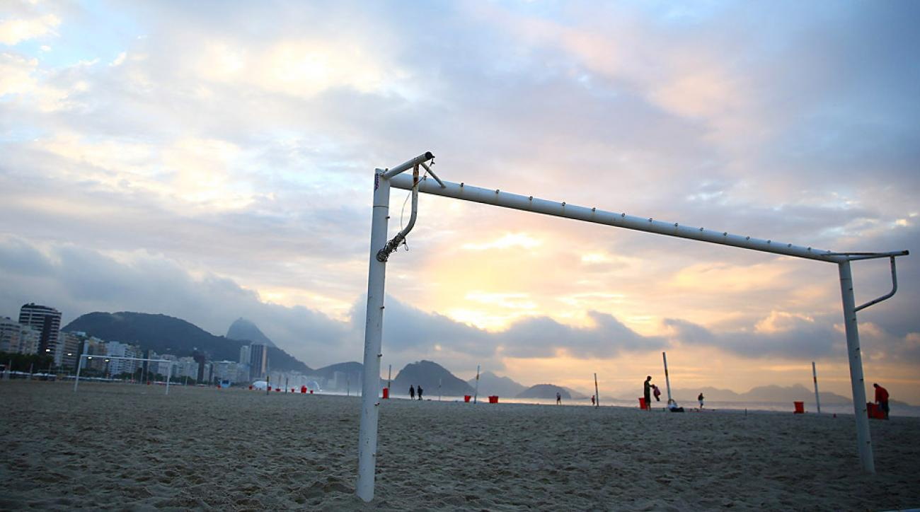 Away from the stadiums themselves, the sun comes up on Copacabana beach in Rio de Janeiro, and that means that the soccer is nearby -- always..