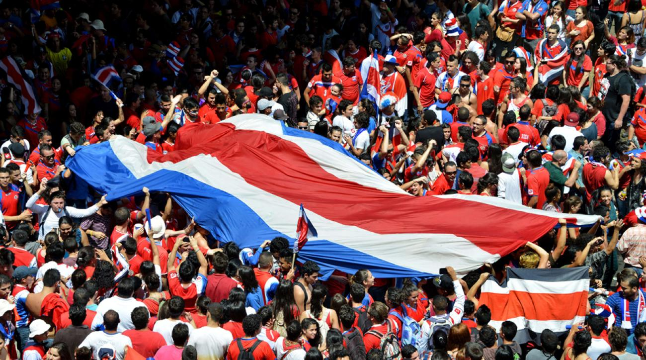 Fans line the streets of San Jose, Costa Rica, celebrating the nation's win over Italy, which cemented its place in the World Cup knockout stage.