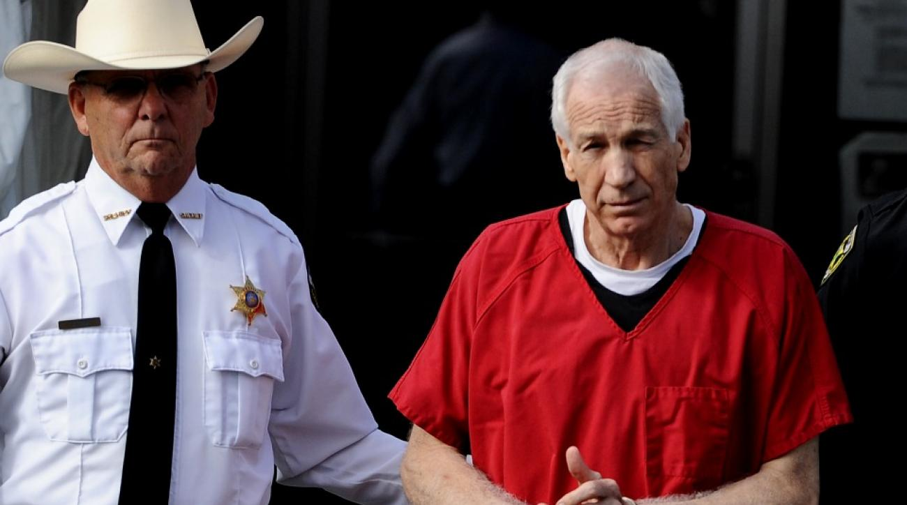 Former Penn State defensive coordinator Jerry Sandusky leaves a Pennsylvania courthouse after sentencing