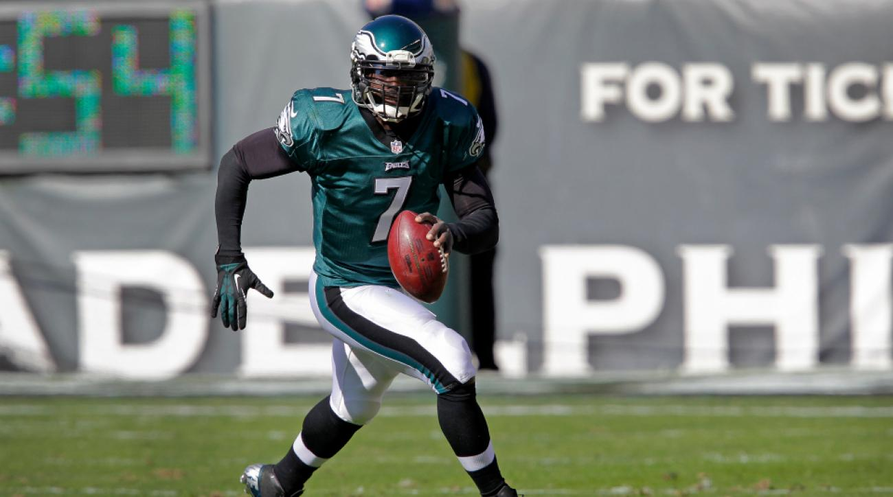 Michael Vick scrambles to pass while playing for the Philadelphia Eagles