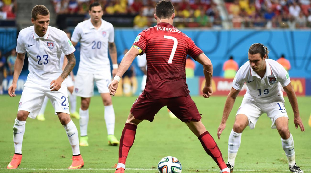 A trio of USA players, (from left) Fabian Johnson, Geoff Cameron and Graham Zusi, try to bottle up Portugal star Cristiano Ronaldo during Sunday's 2-2 draw.