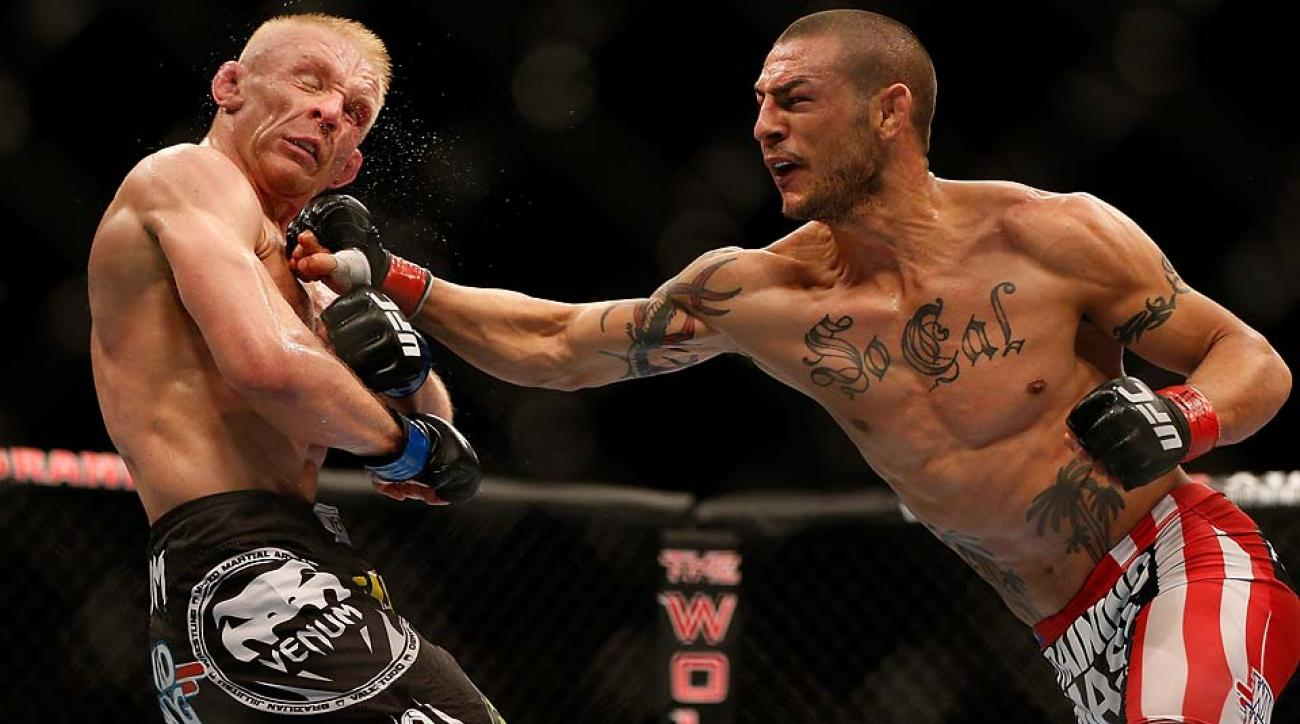 Cub Swanson punches Dennis Siver in their featherweight fight during the UFC 162 event on July 6, 2013 in Las Vegas.