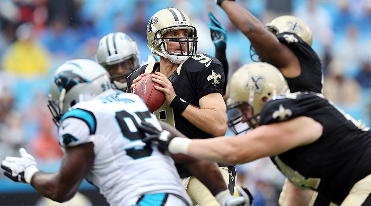 Drew Brees (top) and the Saints should be the heavy favorites in the NFC South in 2014.