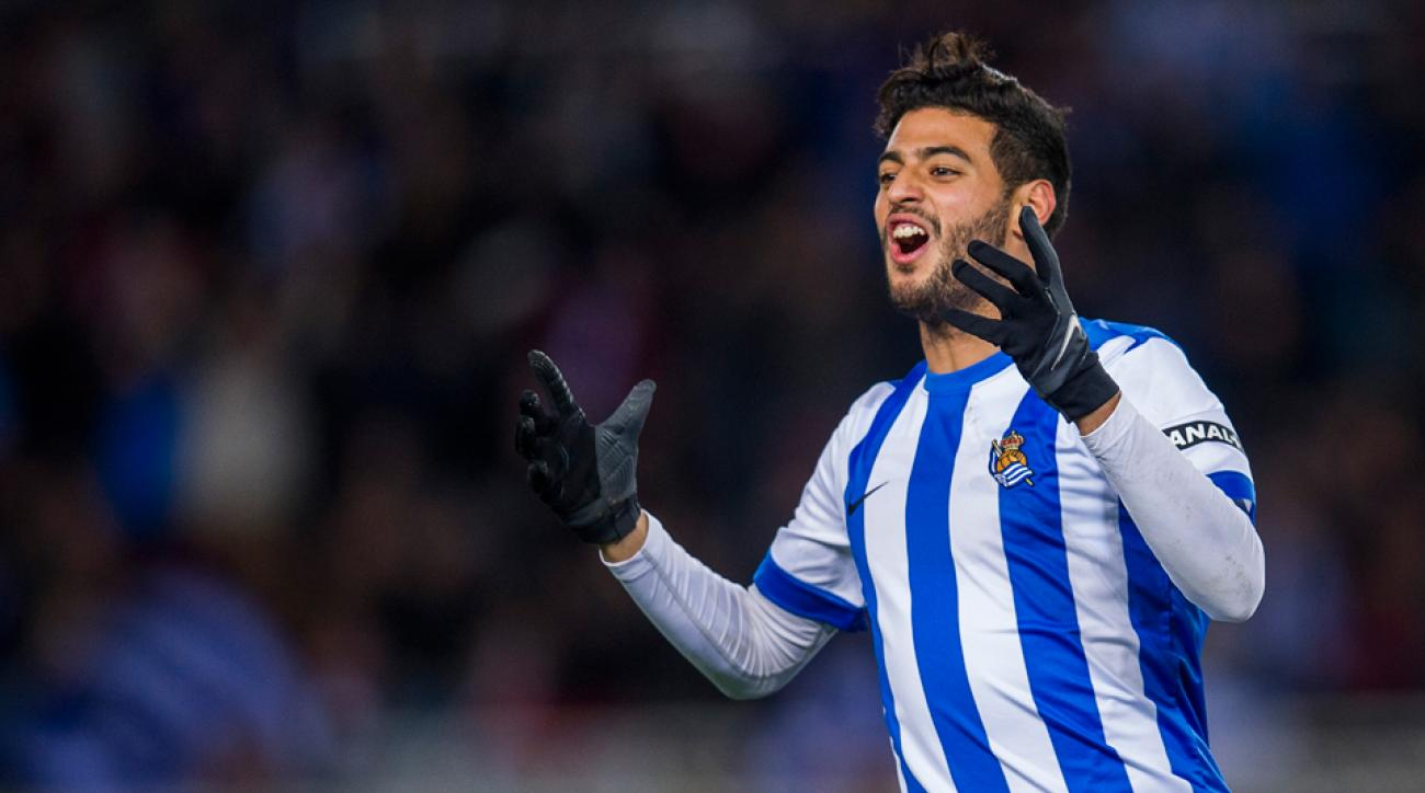 Mexican forward Carlos Vela has signed a four-year deal to remain with Real Sociedad.