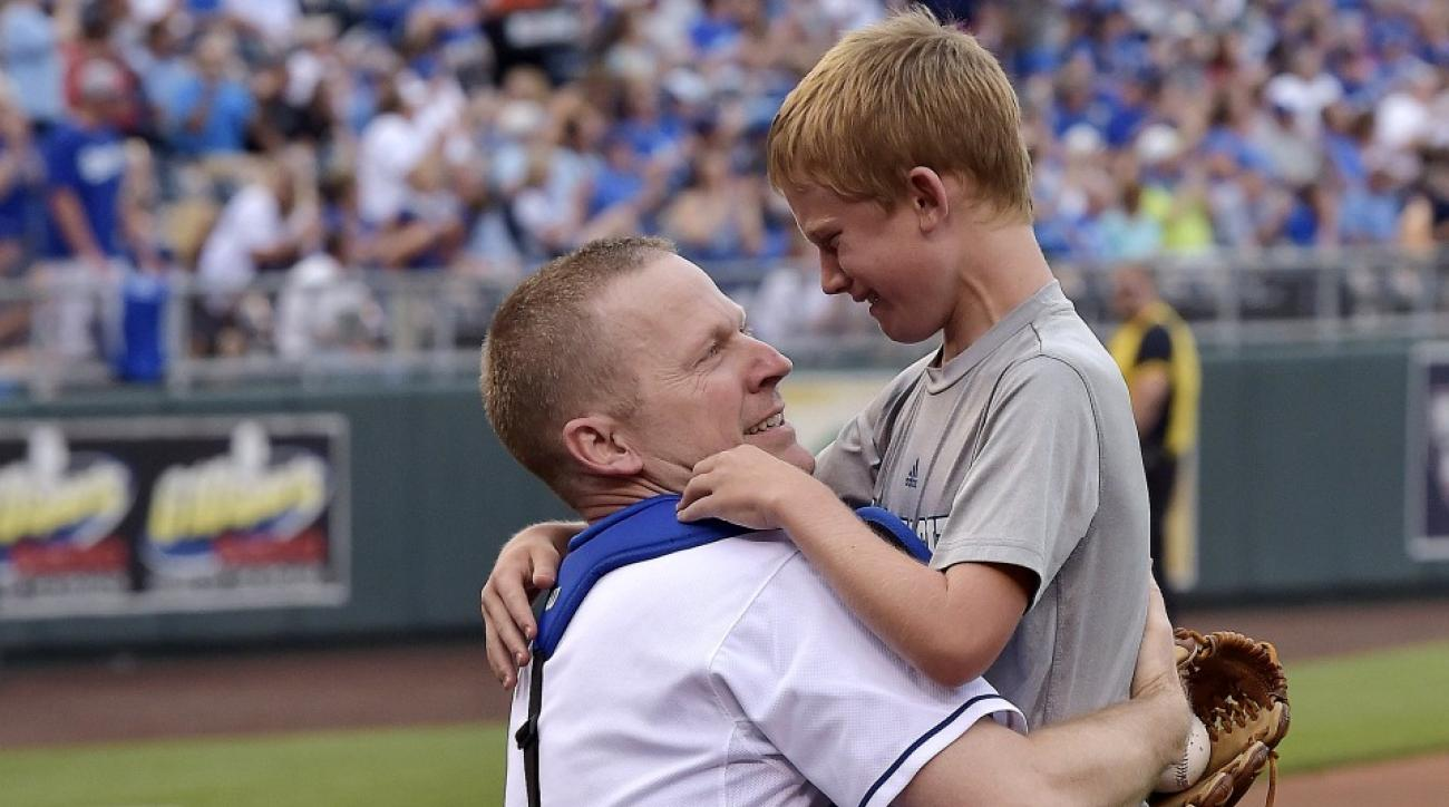 Air Force Major Robert Sides hid in Royals catcher's gear to surprise his son Austin.